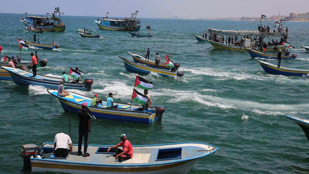 A picture taken on May 29, 2018 shows fishing boats carrying a group of Palestinian activists who are protesting and perhaps trying to breach Israel's naval blockade on Gaza, setting to sail from Gaza City harbour. The Gaza Strip has been under Israe