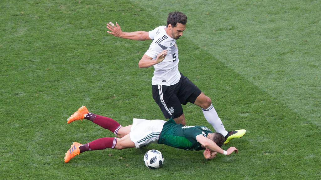 June 17, 2018 - Moscow, Russia - Javier Hernandez of Mexico vies Mats Hummels of Germany during the Russia 2018 World Cup Group F football match between Germany and Mexico at the Luzhniki Stadium in Moscow on June 17, 2018. Germany v Mexico: Group F