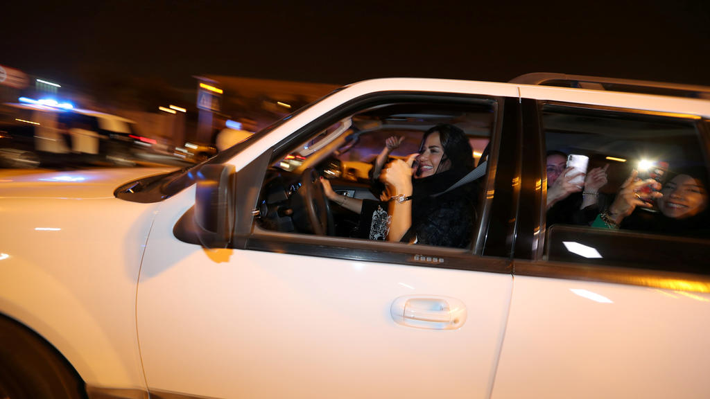 A Saudi woman celebrates with her friends as she drives her car in Al Khobar, Saudi Arabia, June 24, 2018. REUTERS/Hamad I Mohammed     TPX IMAGES OF THE DAY