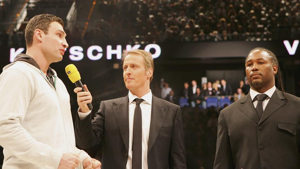 MANNHEIM, GERMANY - MARCH 10: Vitali Kitschko (L) of Ukraine speaks as Lennox Lewis (R) of Great Britain looks on prior to the IBO and IBF World Heavyweight Championship fight between Wladimir Klitschko and Ray Austin at the SAP Arena on March 10, 20
