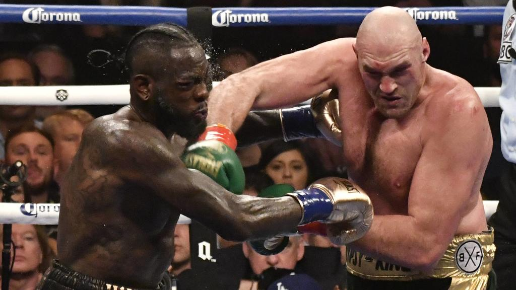 (in color trunks) Deontay Wilder goes 12 rounds with Tyson Fury at the Staple Center Saturday. The fight was draw between both fighters from the judges scoring . Los Angeles, CA. Dec 1,2018. . Wilder-vs-Fury-BOXING PUBLICATIONxINxGERxSUIxAUTxONLY - Z