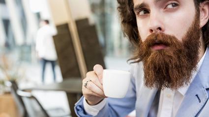 Stylish businessman drinking espresso in a cafe model released Symbolfoto PUBLICATIONxINxGERxSUIxAUT