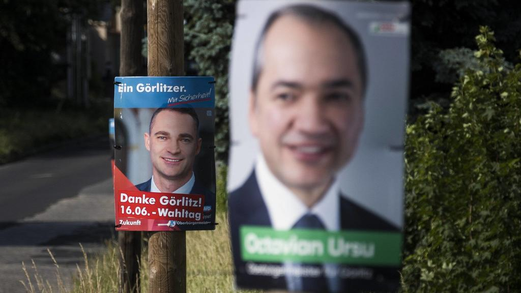 Wahlplakate von Octavian Ursu (CDU) und Sebastian Wippel (AfD), aufgenommen in Goerlitz, 12.06.2019. Ursu (CDU) tritt gegen Wippel (AfD) in einer Stichwahl um das Amt des Oberbuergermeisters an. Bei der ersten Wahl am 26. Mai 2019 erlangte Wippel 36,