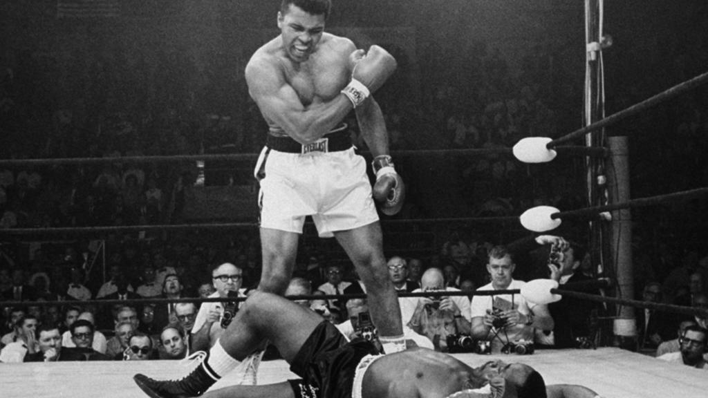 FILE - In this May 25, 1965, file photo, heavyweight champion Muhammad Ali stands over fallen challenger Sonny Liston, shouting and gesturing shortly after dropping Liston with a short hard right to the jaw in the first round of their title fight in