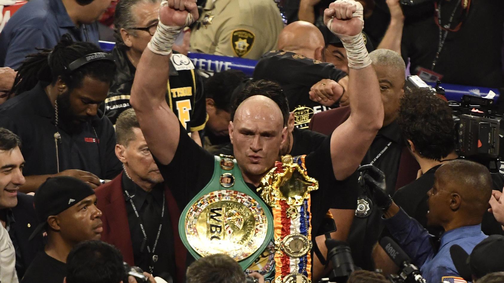 LAS VEGAS, NV - FEBRUARY 22: Tyson Fury holds his belts after going 7 rounds with Deontay Wilder at the MGM Grand Hotel