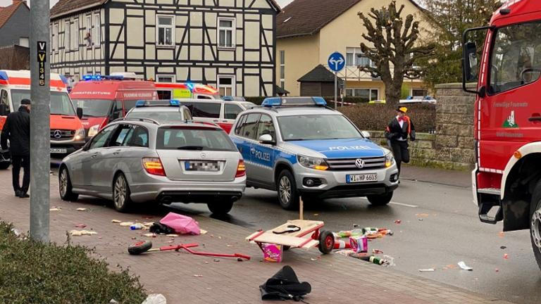 People react at the scene after a car ploughed into a carnival parade injuring several people in Volkmarsen, Germany February 24, 2020. ATTENTION:NUMBER PLATE WAS PIXELATED FROM SOURCE.     Elmar Schulten/Waldeckische Landeszeitung via REUTERS.