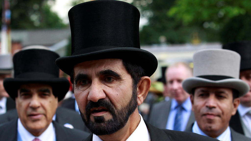 FILE PHOTO: Dubai ruler Sheikh Mohammed bin Rashid al-Maktoum arrives for Ladies Day, the third day of racing at Royal Ascot in southern England June 16, 2011.  REUTERS/Suzanne Plunkett/File Photo