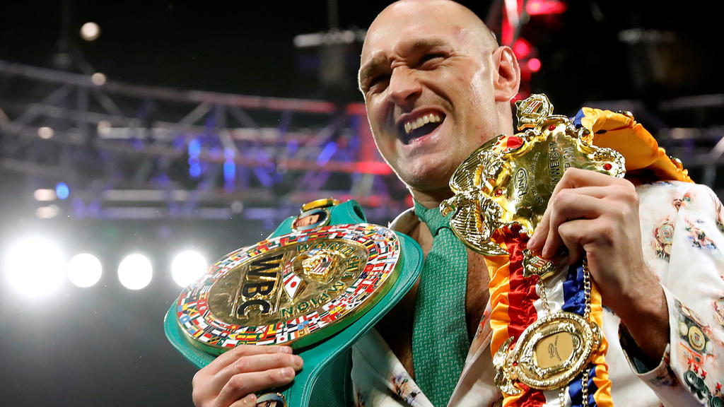 FILE PHOTO: Boxing - Deontay Wilder v Tyson Fury - WBC Heavyweight Title - The Grand Garden Arena at MGM Grand, Las Vegas, United States - February 22, 2020 Tyson Fury poses with his belts during a press conference after the fight REUTERS/Steve Marcu