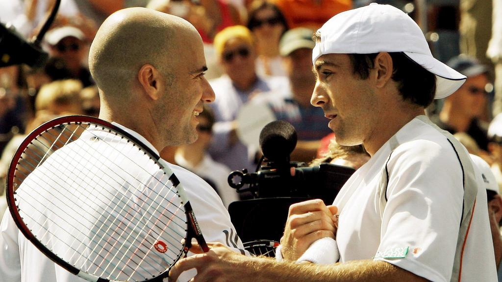 Andre Agassi (L) the United States shakes hands with Benjamin Becker of Germany after losing the final match of his career in their third round match on the seventh day of the 2006 US Open tennis tournament in Flushing Meadows, New York on Sunday 03