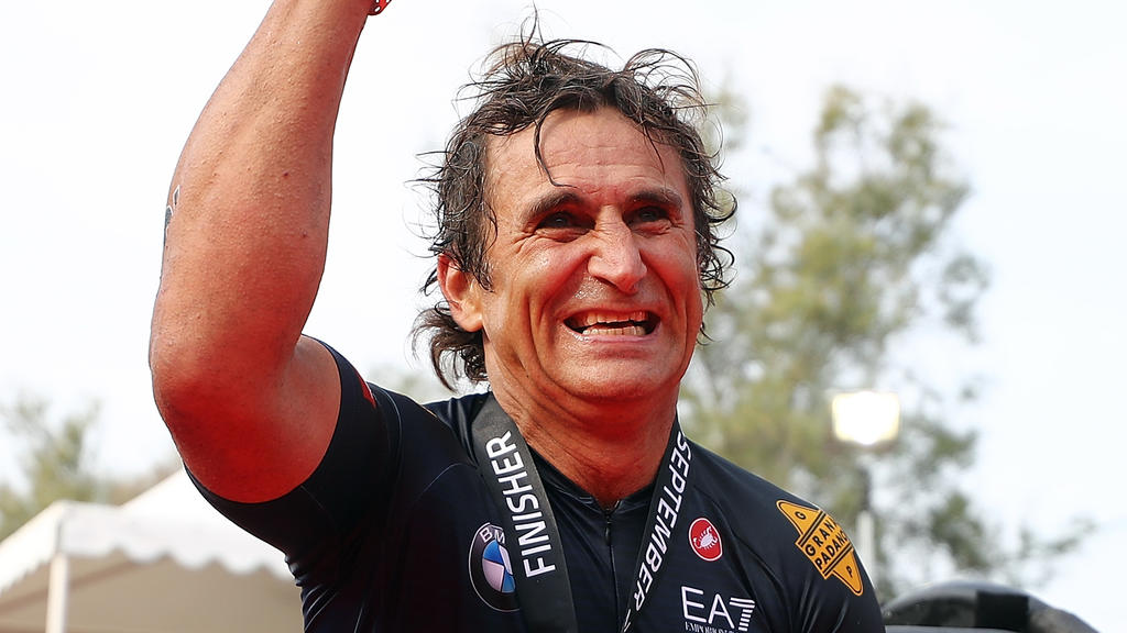 FILE PHOTO - Paralympian And Former Race Driver Alex Zanardi Reported Injured In A Road Accident - CERVIA, ITALY - SEPTEMBER 22:  Racing Driver Alessandro Zanardi of Italy celebrates finishing IRONMAN Emilia Romagna on September 21, 2018 in Cervia, I