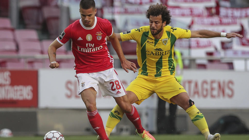 Benfica's player Julian Weigl, left, vies for the ball with Tondela's Joao Pedro during a Portuguese League soccer match between Benfica and Tondela in Lisbon, Portugal, Thursday, June 4, 2020. The Portuguese League soccer matches resumed Wednesday w