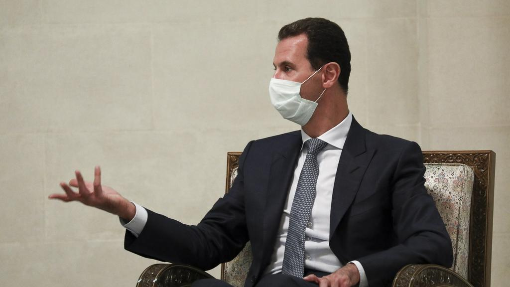 FILE - In this Monday, Sept. 7, 2020 file photo released by Russian Foreign Ministry Press Service, Syrian President Bashar al-Assad gestures while speaking to Russian Foreign Minister Sergey Lavrov during their talks in Damascus, Syria. U.N.-backed