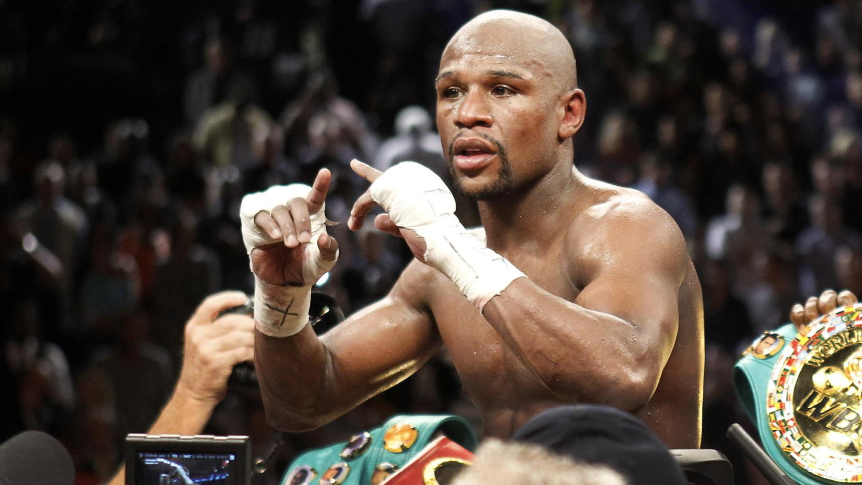Undefeated WBC welterweight champion Floyd Mayweather Jr. of the U.S. celebrates his victory over Robert Guerrero, also of the U.S., at the MGM Grand Garden Arena in Las Vegas