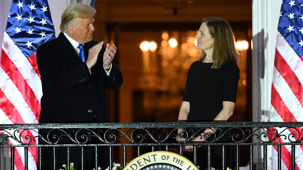 President Donald Trump applauds Judge Amy Coney Barrett after she took her Constitutional oath to become a Supreme Court justice, at the White House in Washington, DC on Monday, October 26, 2020. Earlier today Barrett was confirmed by the Senate, 52