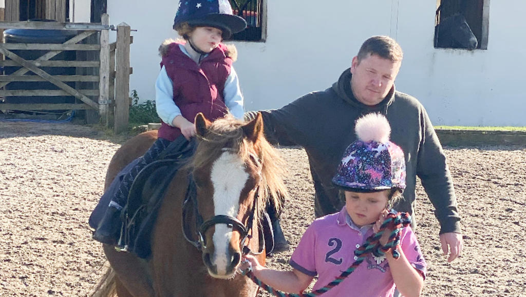 CATERS - (PICTURED: Crystal, 8, and Hallie, 3, at horse riding school).Meet the couple who are happy to label themselves Britain's pushiest parents - who say they'll stop at nothing to see their kids succeed. Sophie and Phil McGennity are determined