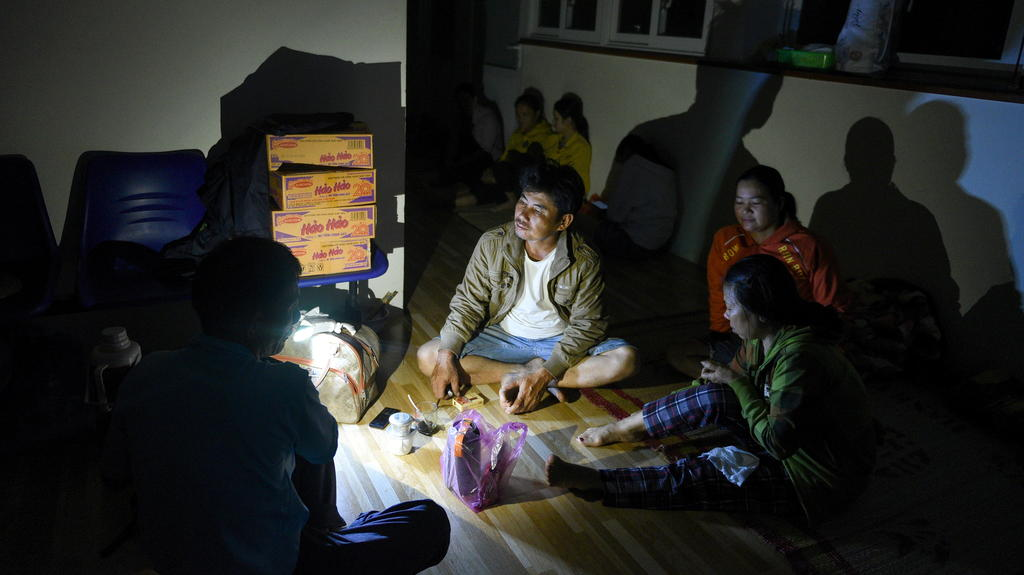 Family waits in a shelter as Typhoon Molave lashes Vietnam's coast in Binh Chau village, Quang Ngai province October 28, 2020. REUTERS/Thanh Hue NO RESALES. NO ARCHIVES