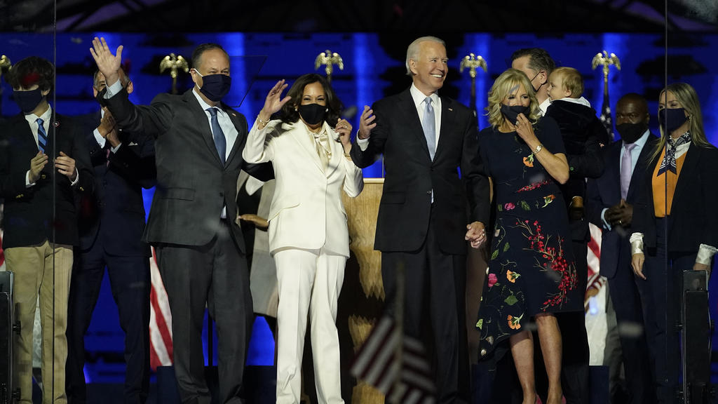 From left, Doug Emhoff, husband of Vice President-elect Kamala Harris, Harris, President-elect Joe Biden and his wife Jill Biden on stage together, Saturday, Nov. 7, 2020, in Wilmington, Del.(AP Photo/Andrew Harnik, Pool)