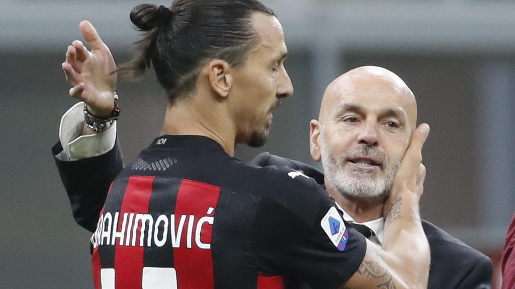 AC Milan's manager Stefano Pioli embraces Zlatan Ibrahimovic at the end of the Serie A soccer match between Inter Milan and AC Milan at the San Siro Stadium, in Milan, Italy, Saturday, Oct. 17, 2020. Ibrahimovic scored both goals in AC Milan 2 - 1 vi