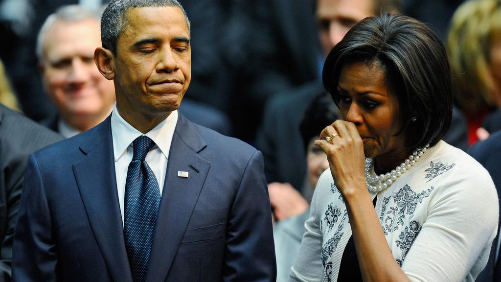President Barack Obama L comforts his wife first lady Michelle Obama after his speech at the event Together We Thrive: Tucson and America honoring the January 8 shooting victims at McKale Memorial Center on the University of Arizona campus on Januar