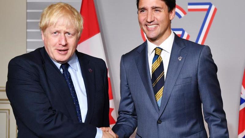 Großbritannien und Kanada haben in einemVideogespräch ein vorläufiges Handelsabkommen unterzeichnet. Foto: Jeff J Mitchell/PA Wire/dpa