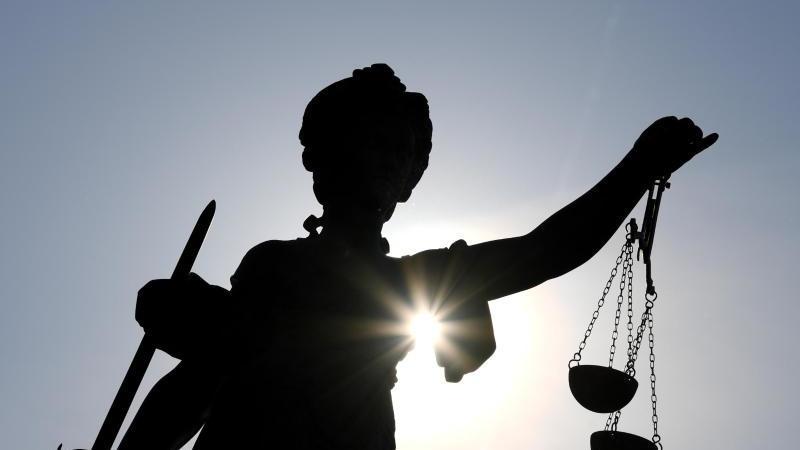 Justitia-Statue. Foto: Arne Dedert/dpa/Archivbild