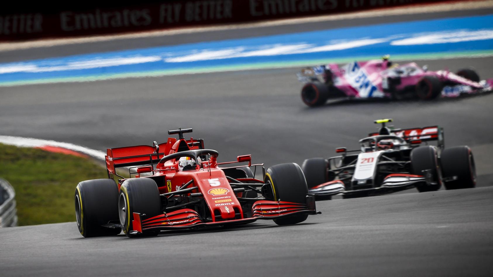 2020 Eifel GP NüRBURGRING, GERMANY - OCTOBER 11: Sebastian Vettel, Ferrari SF1000, leads Kevin Magnussen, Haas VF-20 du