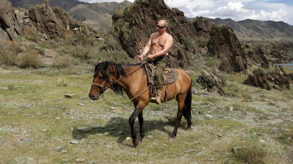 Russia's Prime Minister Vladimir Putin rides a horse in southern Siberia's Tuva region in this August 3, 2009 file photo. Russians will go to the polls on March 4, 2012, to choose one of five candidates to be their new president. Picture taken August