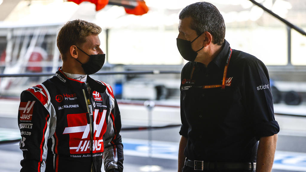 2020 Abu Dhabi GP YAS MARINA CIRCUIT, UNITED ARAB EMIRATES - DECEMBER 10: Mick Schumacher, Haas F1, with Guenther Steiner, Team Principal, Haas F1 during the Abu Dhabi GP at Yas Marina Circuit on Thursday December 10, 2020 in Abu Dhabi, United Arab