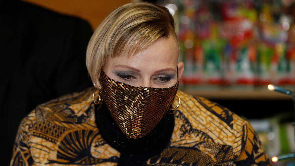 Princess Charlene of Monaco, wearing a protective face mask, attends the traditional Christmas tree ceremony at the Monaco Palace, as part of Christmas holiday season in Monaco, December 16, 2020. REUTERS/Eric Gaillard/Pool