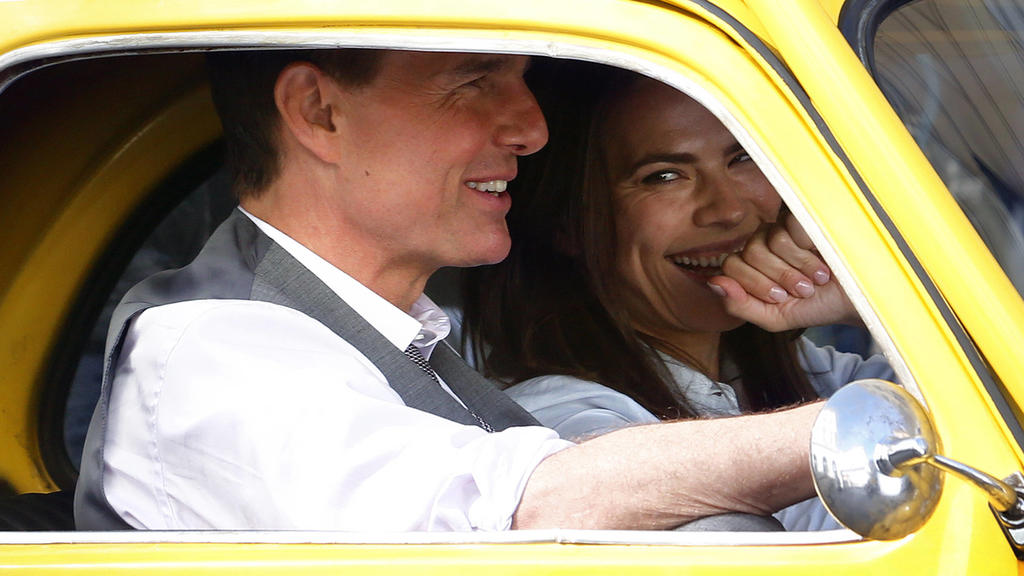 Actor Tom Cruise and actress Hayley Atwell in a yellow Fiat 500 on the set of the film Mission Impossible 7 shot in Via Nazionale. Rome Italy, October 9th 2020 Photo Samantha Zucchi Insidefoto SamanthaxZucchi