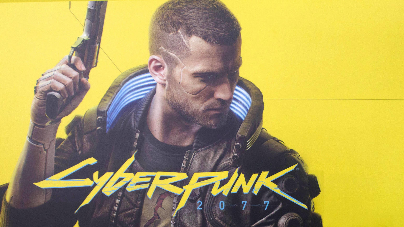 December 10, 2020, Moscow, Russia: A worker wearing a glove displays a game disc on the shelf..Cyberpunk 2077 is a 2020