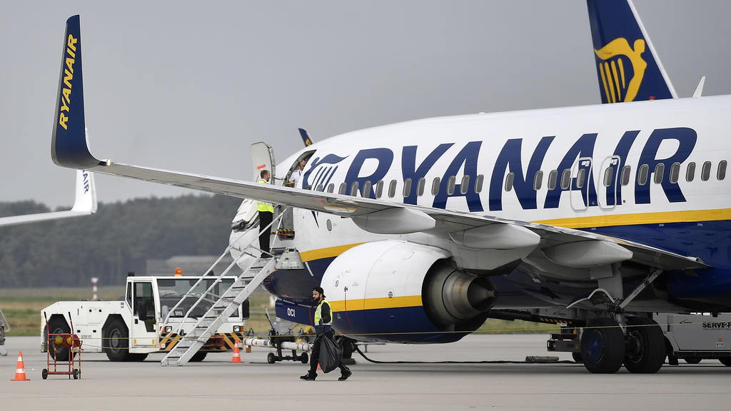 FILE - In this Sept. 12, 2018 file photo, a Ryanair plane parks at the airport in Weeze, Germany. Boeing's troubled 737 Max jet is getting a vote of confidence from Ireland's Ryanair, one of Europe's biggest budget airlines.  Ryanair announced Thursd