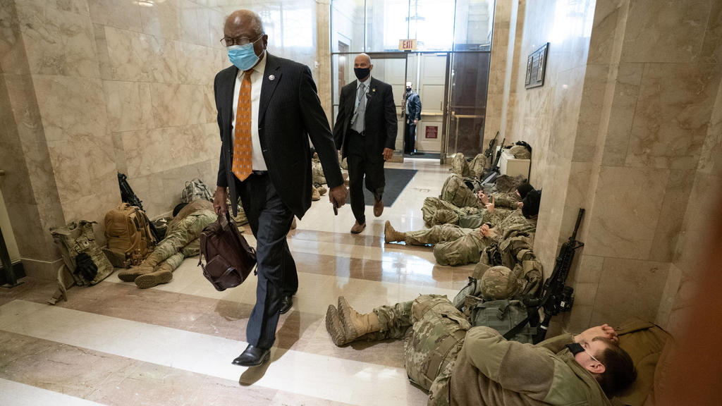 House Majority Whip James Clyburn walks past sleeping members of the National Guard inside the U.S. Capitol as security is increased ahead of the inauguration of President-elect Joe Biden, in Washington, DC on January 13, 2021. PUBLICATIONxINxGERxSU