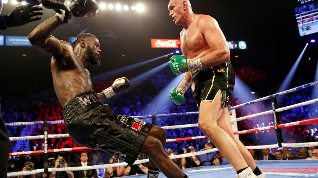 Boxing - Deontay Wilder v Tyson Fury - WBC Heavyweight Title - The Grand Garden Arena at MGM Grand, Las Vegas, United States - February 22, 2020 Tyson Fury knocks down Deontay Wilder during the fight REUTERS/Steve Marcus/File Photo     TPX IMAGES OF