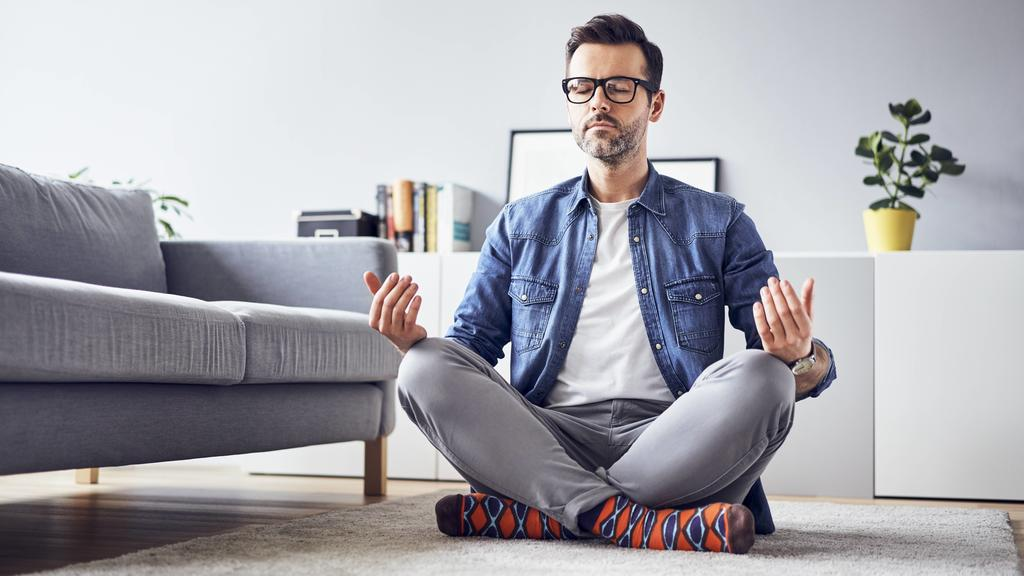 Relaxed man meditating at home model released Symbolfoto property released PUBLICATIONxINxGERxSUIxAUTxHUNxONLY BSZF00303