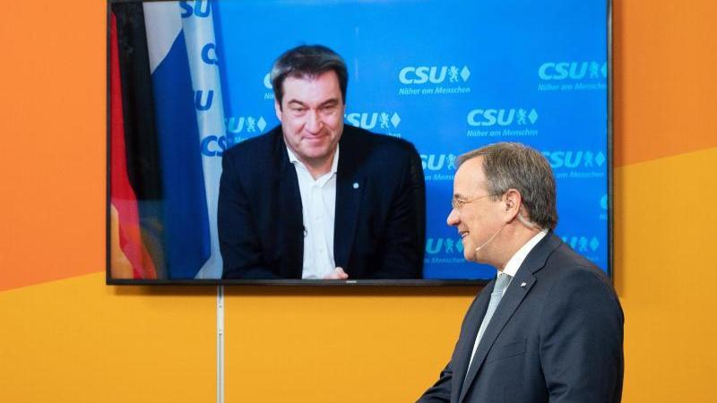 Armin Laschet und Markus Söder beim digitalen Neujahrsempfang der CDU in Nordrhein-Westfalen. Foto: Federico Gambarini/dpa-POOL/dpa/Archivbild