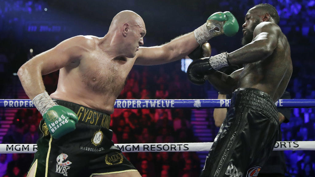 FILE - In this Feb. 22, 2020, file photo, Tyson Fury, left, of England, fights Deontay Wilder during a WBC heavyweight championship boxing match in Las Vegas. Fury is turning his attention to an all-British heavyweight unification bout with Anthony J
