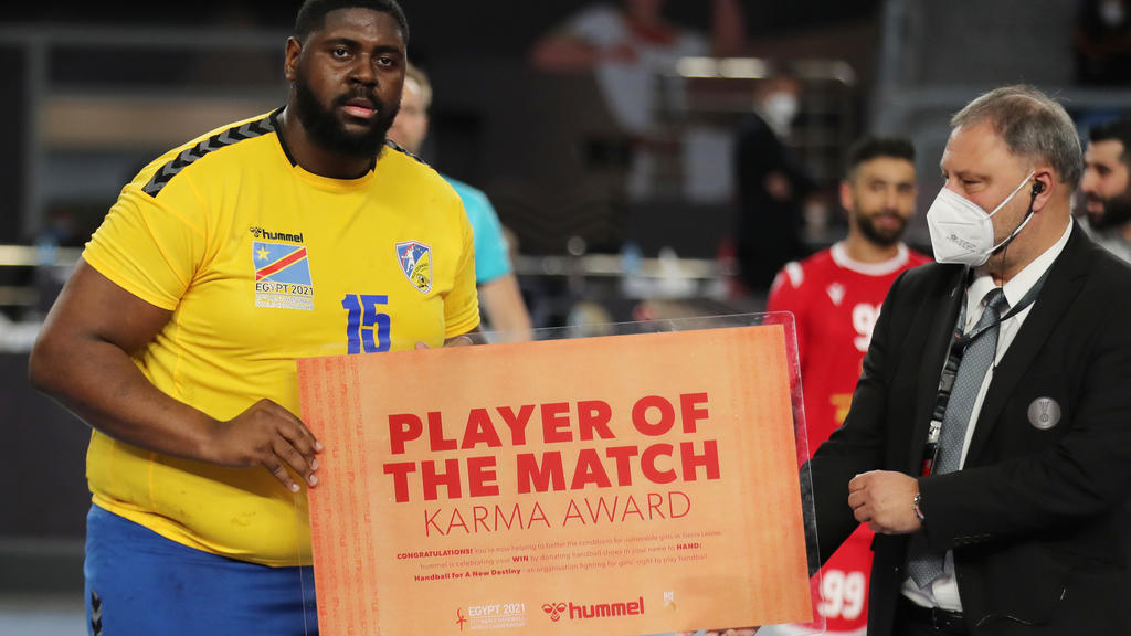 Handball - 2021 IHF Handball World Championship - Preliminary Round Group D - Bahrain v D.R. Congo - Cairo Stadium Hall 1, Cairo, Egypt - January 19, 2021 D.R. Congo's Gauthier Mvumbi Thierry  with the Player of the Match award after the match Pool v