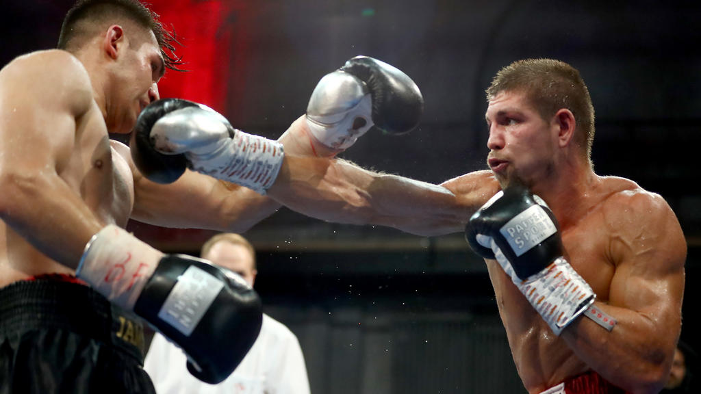BERLIN, GERMANY - AUGUST 28: Vincent Feigenbutz (R) of Germany exchanges punches with Jama Saidi of Germany during their IBF Interconti Middleweight title fight between Vincent Feigenbutz and Jama Saidi during the AGON Fight Night at Havelstudios on