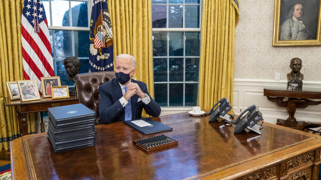 January 20, 2021, Washington, District of Columbia, USA: United States President Joe Biden signs executive order on Covid-19 during his first minutes in the Oval Office, Wednesday, Jan. 20, 2021. President Biden as the 46th president of the United S
