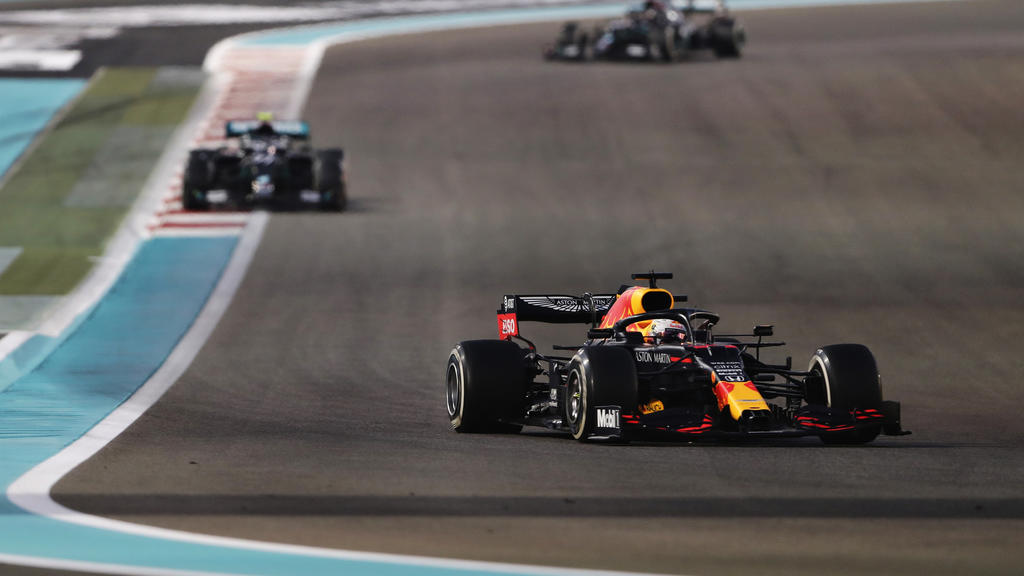ABU DHABI, UNITED ARAB EMIRATES - DECEMBER 13: Max Verstappen of the Netherlands driving the (33) Aston Martin Red Bull Racing RB16 leads Valtteri Bottas of Finland driving the (77) Mercedes AMG Petronas F1 Team Mercedes W11 during the F1 Grand Prix