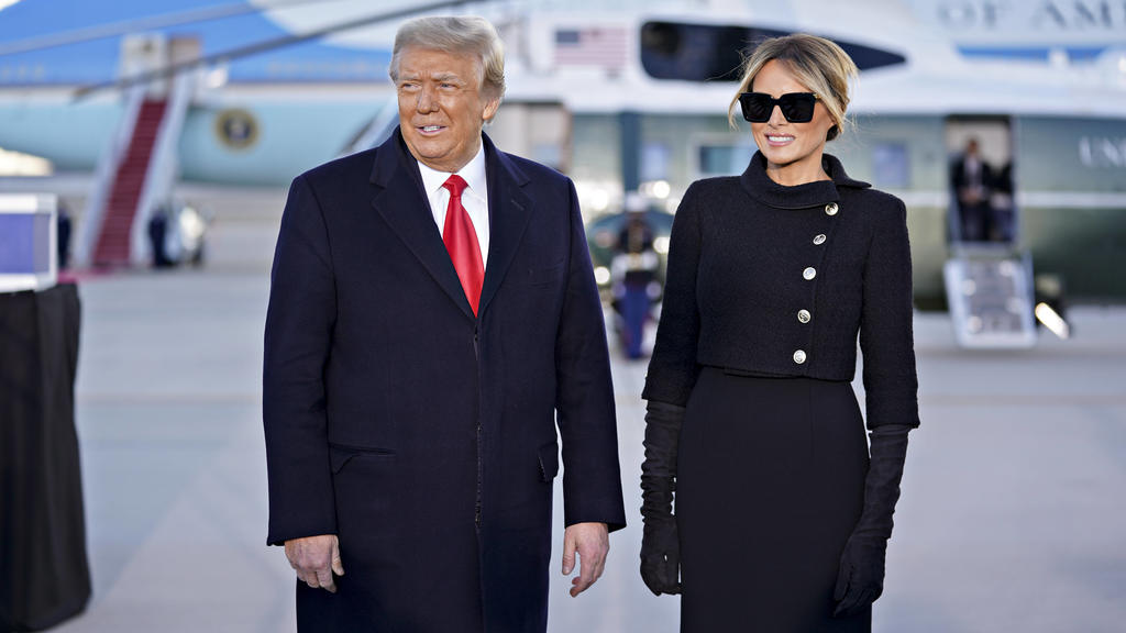 U.S. President Donald Trump, left, and U.S. First Lady Melania Trump arrive to a farewell ceremony at Joint Base Andrews, Maryland, U.S., on Wednesday, Jan. 20, 2021. Trump departs Washington with Americans more politically divided and more likely t