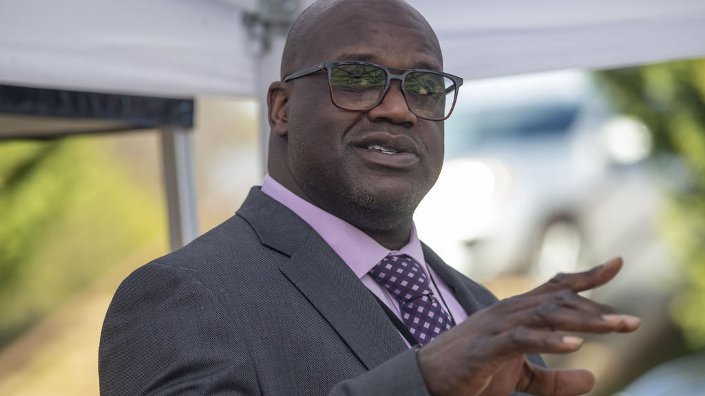 Basketball Hall of Famer Shaquille O'Neal speaks at a press conference in McDonough, Ga., Friday, Jan. 22, 2021, after being named Henry County Sheriff's Office Director of Community Relations by Henry County Sheriff Reginald Scandrett.  (Alyssa Poin
