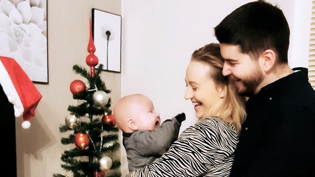 Maxim mit seinen Eltern