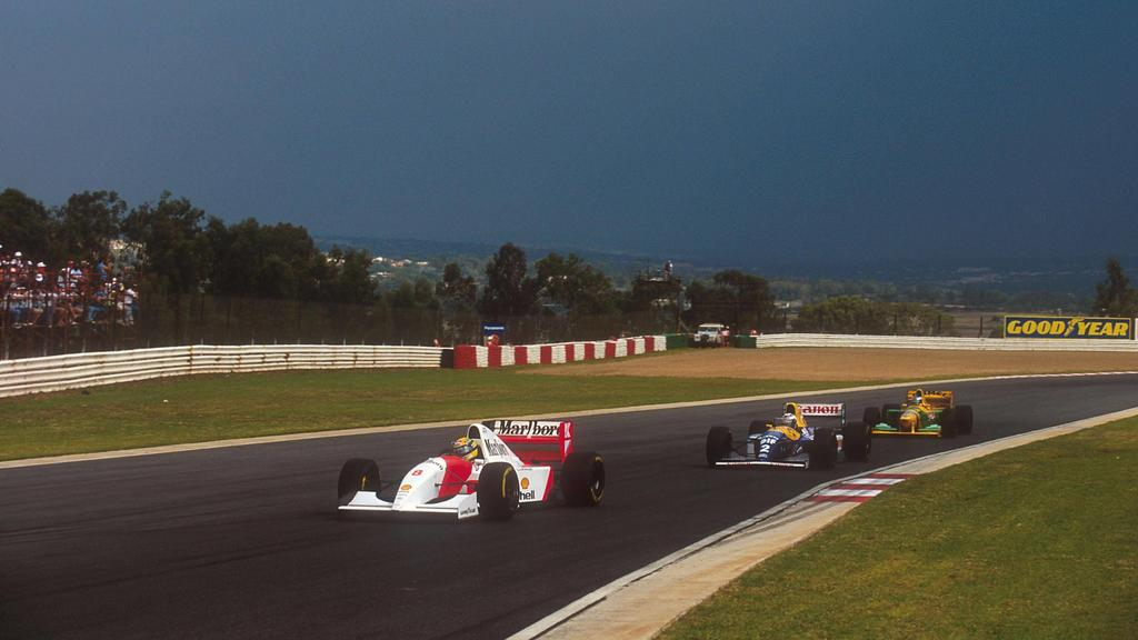 1993 South African Grand Prix. Kyalami, South Africa. 12-14 March 1993. Ayrton Senna McLaren MP4/8 Ford leads Alain Prost Williams FW15C Renault and Michael Schumacher Benetton B192B Ford. Ref-93 SA 01. World Copyright - LAT Photographic ACHTUNG AUF