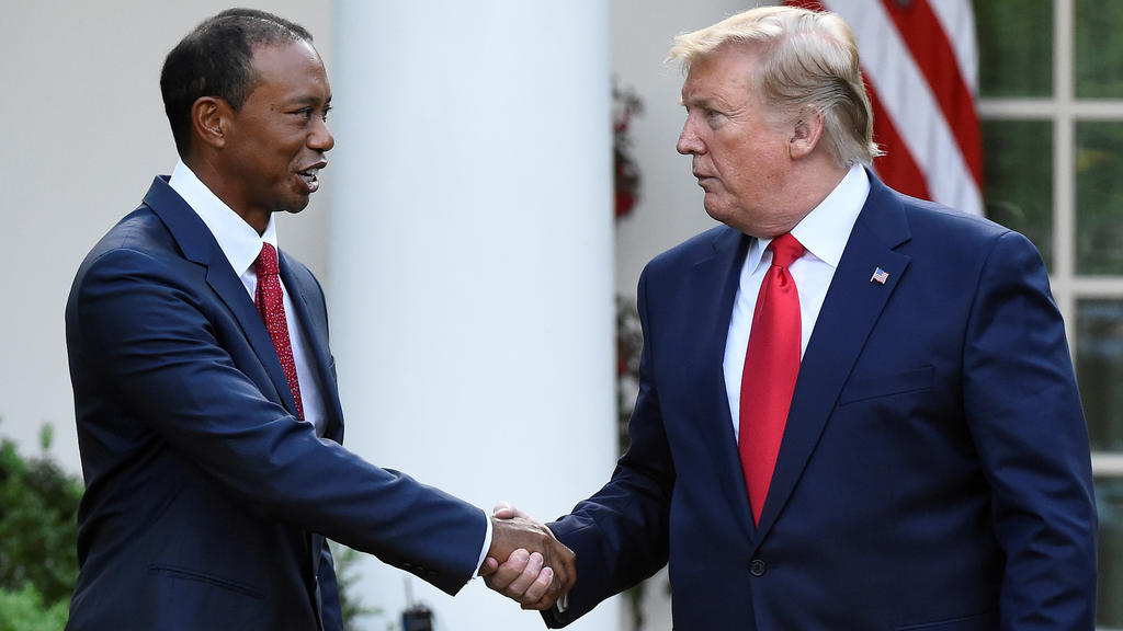 FILE PHOTO: Golfer Tiger Woods is awarded the Presidential Medal of Freedom, the nation's highest civilian honor, by U.S. President Donald Trump in the Rose Garden at the White House in Washington, U.S., May 6, 2019. REUTERS/Clodagh Kilcoyne/File Pho