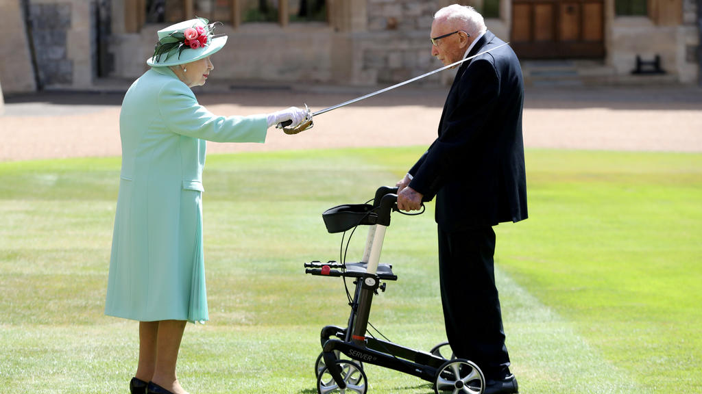 FILE PHOTO: Britain's Queen Elizabeth awards Captain Tom Moore with the insignia of Knight Bachelor at Windsor Castle, in Windsor, Britain July 17, 2020. Chris Jackson/Pool via REUTERS     TPX IMAGES OF THE DAY/File Photo