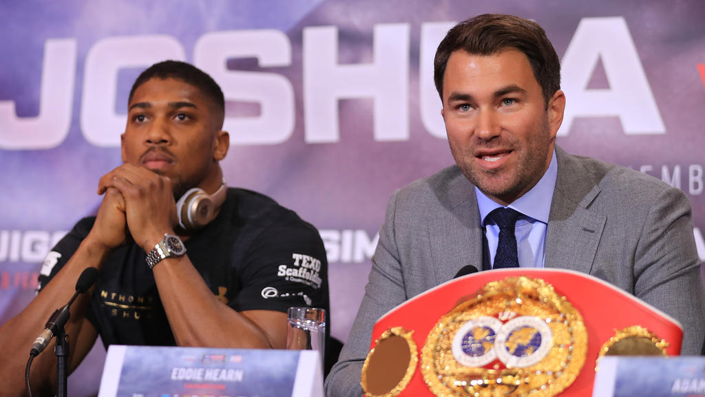 LONDON, ENGLAND - APRIL 27:  Eddie Hearn, boxing promoter (R) and Anthony Joshua  (L) speak during a press conference for his Super Heavyweight title fight against Wladamir Klitschko at Sky Sports Studios on April 27, 2017 in London, England. Anthony