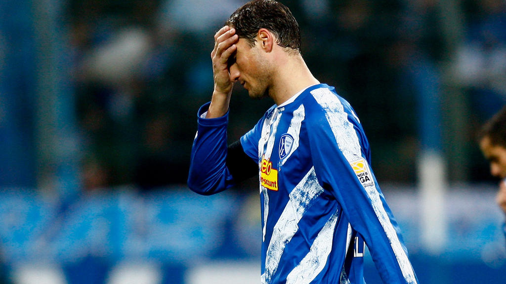 BOCHUM, GERMANY - NOVEMBER 07:  Diego F. Klimowicz and Mimoun Azaouagh walk off dejected during the Bundesliga match between VfL Bochum and SC Freiburg at the Rewirpower Stadium on November 07, 2009 in Bochum, Germany.  (Photo by Friedemann Vogel/Bon