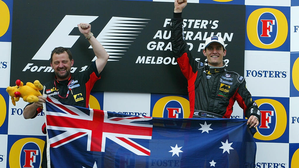 3 Mar 2002:  Mark Webber of Australia and Minardi celebrates with team boss Paul Stoddart after his 5th place finish in the 2002 Fosters Australian Grand Prix  at the Albert Park Circuit, Melbourne, Australia. DIGITAL IMAGE. Mandatory Credit: Mark Th